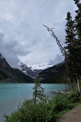 A Walk Along the Lake (Patricia Henschen) Tags: banff banffnationalpark parks parcs canada alberta lakelouise lake clouds mountains canadian rockies northern rockymountains pathscaminhos lakeshore trail