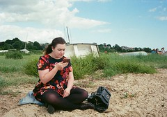 op - chloe takes five minutes (johnnytakespictures) Tags: olympus pen ee3 halfframe lomographycn400 lomo lomography analogue film merseaisland essex westmersea chloelee chloe girl woman cute pretty dress beach sand seafront chill chilling relax relaxing sitting