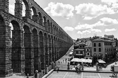 The Roman Aqueduct at Segovia, Spain (PM Kelly) Tags: iphone street spain bw bnw blackandwhite segovia aqueduct roman espana el puente