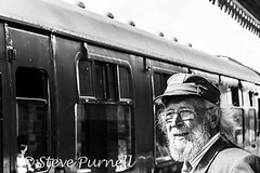 The Stationmaster 2 (Steve Purnell Photography) Tags: stationmaster station travel train transport rail conductor railroad tourism transportation symbol trip employee hat background jacket people tie uniform professional happy safety holiday mustache isolated service old thumb tour person