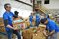 BBVA Volunteers (CFBCA) Tags: warehouse bbva volunteer volunteers blue boxes food foodbank packing charity community central alabama bank cans volunteering together working sorting
