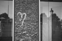 Love in the past, present and future (Alexandre Dulaunoy) Tags: sooc bw graffiti nb noirblanc blackwhite rue street streetart artderue windows