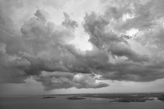 Clouds over NY Harbor, August 2011 (Jay Fine) Tags: blackandwhite clouds landscape island harbor ellis statueofliberty