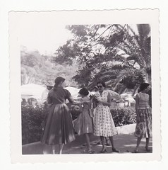 We're Looking at Flowers (Calsidyrose) Tags: vacation blackandwhite vintage print photography hawaii women florida sightseeing tourists dresses 1950s tropical thriftstore 1960s botanicalgarden touring foundphotograph coraltree
