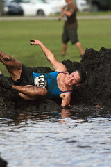 Proper form (taddzilla) Tags: water race sunrise mud florida running dirty dirt athlete muck allrightsreserved 2012 rollingin markhampark muddogs5k