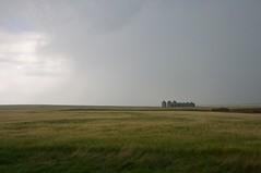 Distant (The Yarn Geek) Tags: sky cloud weather clouds raw farm farming grain bin alberta prairies grainbins