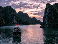 Obligatory Ha Long Bay sunset shot (Maren 86) Tags: vietnam asia boat ship water cruise ocean sea sunset karsts rocks mountains hills lumixg7 microfourthirds
