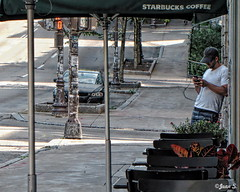 Nonchalance (Jean S..) Tags: street streetphoto candid male guy phone sidewalk