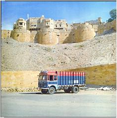 .people live above you, postured like a totem (Herr Benini) Tags: 6x6 analog kiev88 india indien jaisalmer rajasthan car truck