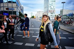 Berlin is My Beat (Steve Lundqvist) Tags: berlin berlino germany germania deutschland crossroad street photography cap baseball batman tshirt jacket leather womenswear sweater fleece crossing cross people travel traveller pedestrian passing nikon nikkor 24mm f28 urban city downtown
