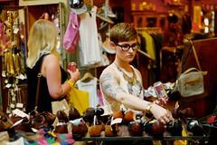 Tattooed girl browsing in Blitz vintage fashions (hethelred) Tags: road leica brick girl shop vintage shoes market bokeh antique lane blitz browsing fashions m9 hanbury tattooed