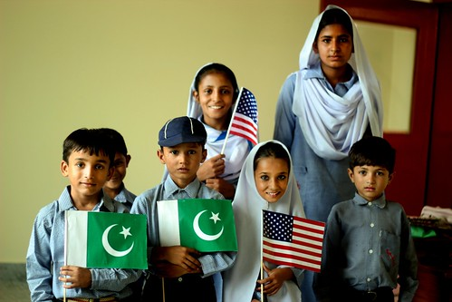 Pakistani Children pose with American and Pakistani flags