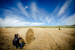 Spot the Photographer? (s0ulsurfing) Tags: uk blue autumn light shadow england sky cloud sunlight tractor english texture nature lines weather clouds composition rural canon landscape island countryside scenery skies photographer natural britain pov farm patterns country farming rustic wide perspective straw blues wideangle september vectis isleofwight vista fields british hay agriculture bales bale landschaft isle wight bucolic foreground 2012 bailing 10mm leadinglines sigma1020 leadin s0ulsurfing vertorama bucolical worzels findbritain welcomeuk
