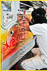 Artist at work prepares masking for airbrush at Philippinne Jeepney Arts Contest (ROMMEL BANGIT D311) Tags: life colour photography colorful asia philippines arts photojournalism naturallight event ourworld getty times geography xxx society feature gettyimages stockphoto corbis lightingsystem ncr ngs mabuhay colorimage nationalgeographicsociety mallofasia pasaycity nationalcapitalregion coloredimage melphoto rommelbangit corbisimages demotix jeepneyartsfestival