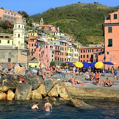 Cooling down in the deep blue Ligurian Sea at Vernazza (Bn) Tags: santa travel blue sea summer cactus italy sun holiday castle heritage beach church water colors fruit swimming boats harbor fishing sand colorful mediterranean village hiking walk liguria tourist lovers unesco trail vineyards olives cinqueterre charming opuntia vernazza viewpoint picturesque sunbathing margherita sunbather italianriviera ruined nocars pamtree rockycoastline viadellamore dantiochia