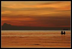 Ko Samui's fishermen (RTarluche) Tags: ocean sunset sea orange beach thailand boat asia fishermen gulf