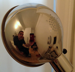Doctor's office selfie (TheMachineStops) Tags: nyc newyorkcity distortion reflection lamp metal mirror manhattan indoor upperwestside uws iphone selfie