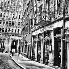 Charming little Stone Street. (goldensummer1200) Tags: blackandwhite cobblestone financialdistrict nyc stonestreet