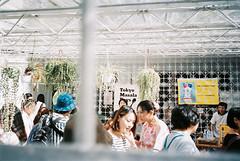 ( ourutopia) Tags: film argenti vividarrow 400 yashica t2 t3 t4 t5 beautyandyouth window graffiti scrawl painting wall expiredfilm yard house vendor market people garagesale japanese