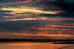 On fire (marielledevalk) Tags: outdoor sky cloud sunset river bridge water evening color windmill fishermen