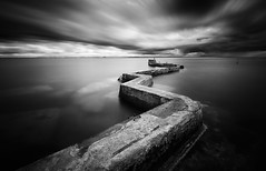 Defiant (Pete Rowbottom, Wigan, UK) Tags: scotland peterowbottom fife landscape seascape longexposurelandscape longexposure blackandwhitelongexposure monochrome mono blackandwhite blacknwhite pier harbour breakwater bulb clouds cloud cloudscape stormclouds light lighting sea marine coast coastal coastalscotland uk uklandscape ukcoast ukcoastline ukseascape dramatic edinburgh stmonans streaks ocean landmark hills eastneuk inexplore