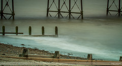 The Ebb and Flow in Worthing (Nathan Dodsworth Photography) Tags: longexposure photography tide ebb flow shingle beach seaside worthing pier groyne seadefences serene calming peaceful wood metal outdoors westsussex
