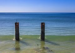 Albufeira (Hans van der Boom) Tags: vacation holiday europe portugal algarve albufeira atlantic ocean sea poles struts rust metal pt