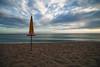 ombrellone giallo chiuso - end of summer (ma[mi]losa) Tags: sea nikon mare d200 2012 endofsummer tokina1116mmf28atx mamilosa micheledefilippo ombrellonegiallochiuso