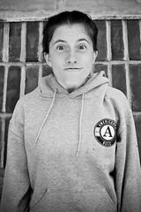 118:365 - Funny Face (KatGatti) Tags: portrait blackandwhite brown face canon hoodie student funny shot head joy government 365 gatti