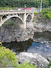 Bellows falls, vermont (bobgladue) Tags: old trestle bridge blue trees england sky brown mountain building green abandoned nature water rock clouds train reflections river rust rocks vermont view natural state bricks great traintracks scenic newengland newhampshire grand nh hampshire historic upper valley owl boxcars vt rundown walpole uppervalley roundhouse bellowsfalls petrogyphs northwalpole greenmountainrailroad indianpetroplyphsbellowsfalls petrogyphsinvermont bobgladue bobgladuegmailcom