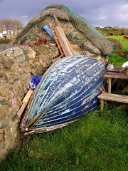 Netted thatch and blue boat (DizDiz) Tags: uk wales island anglesey april2009 olympusc720uz