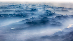 Rocky Mountain High (melfoody) Tags: blue cloud mist canada mountains fog airplane rocky aerial peaks hdr windowseat explored