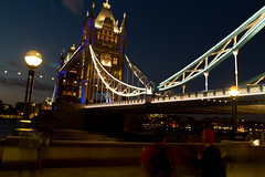 Towering Over (Usuf Islam) Tags: street city uk nightphotography travel bridge england urban colour building london tower art water thames modern clouds towerbridge river landscape photography cityscape nightscape capital wideangle 7d shutter various shard starry atmospheric toweroflondon archtecture cityoflondon lightroom londonskyline
