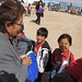Navajo Nation First Lady Martha Shelly greets local school children at the Kids Day events during the 101st Northern Navajo Nation Fair in Shiprock, New Mexico. October 5, 2012. Photo by Jared King / Navajo Nation Washington Office.  This Navajo Nation Washington Office photograph is being made available only for publication by news organizations and/or for personal use printing by the subject(s) of the photograph. The photograph may not be manipulated in any way and may not be used in commercial or political materials, advertisements, emails, products, promotions that in any way suggests approval or endorsement of Navajo Nation President Ben Shelly or Vice President Rex Lee Jim.