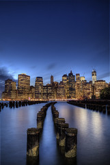 Manhattan Skyline (Subversive Photography) Tags: city nyc longexposure travel newyork reflection skyline night lights sticks cityscape dusk manhattan tourist subversive bigapple hdr moorings amaerica danielbarter