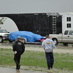 Two team members brave the elements to purchase their pit passes on Friday