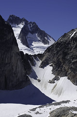 The Bugaboos - Howsers Beyond the Col (Tideline to Alpine Photo, Idiosyncrasy Exemplified) Tags: camping sky mountains expedition clouds hiking spires glacier adventure climbing alpine mountaineering wilderness scrambling alpinism bugaboos thebugs tradclimbing alpineclimbing summitview bugabooprovincialpark howsertowers applebeecamp applebeedome eastpostspire snowpatchbugaboocol