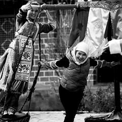 Qinghai performers (a.pierre4840) Tags: olympus om4ti zuiko 55mm f12 fujisuperia400 desaturated bw blackandwhite monochrome noiretblanc qinghai china streetportrait