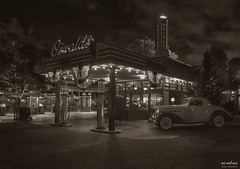 Oswald's Garage (The Mr and The Mrs) Tags: hdr aurorahdr disney disneyparks disneyphotography disneytrips disneyland oswalds oswaldrabbit garage car vintage gas neon availablelight blackandwhite nikon nikondf wwwthemrandthemrscom kristicreedwwwthemrandthemrscom black white retro