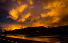 After the Storm II (evanffitzer) Tags: sunset thunderstorm storm clouds weather sun dark canoneos60d gold sillouhette highway water shiny evanfitzer evanffitzer photography outdoors kamloops britishcolumbia