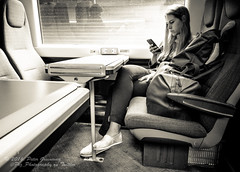 On The Train To Londond - Engrossed In My Mobile ! (Peter Greenway) Tags: train mobilephone chilternrailways londonunderground trainstation concentration engrossed streetphotography woman undergroundstation carriage london