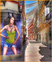 Seville street, HDR (that Geoff...) Tags: street girl canon poster sevilla spain streetscene scene seville andalucia advertisement hdr espania 500d