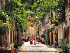 City Life in Freiburg (Habub3) Tags: life street city travel people holiday tree green nature leaves canon germany deutschland reisen place strasse urlaub natur atmosphere sunny powershot menschen stadt passage freiburg baum hdr vacanze leben streetview 2012 g12 stadtleben konviktstrasse habub3 mygearandme