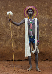 Suri Singer, Kibish, Ethiopia. (Eric Lafforgue) Tags: africa portrait people color hat vertical outside outdoors photography necklace day serious fulllength culture tribal adobe singer omovalley tradition ethiopia tribe ethnic surma oneperson tribo hornofafrica ethnology omo eastafrica thiopien suri etiopia tribesman ethiopie realpeople etiopa colorimage lookingatcamera 6163  etiopija africanethnicity pastoralist ethiopi  etiopien etipia kibish  etiyopya  snnpr      oneadult    southernnationsnationalitiesandpeoplesregion kibbish ethiopianethnicity