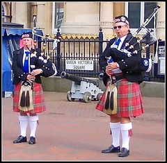 Two Pipers .. (* Janets Photos*Site to slow to Comment) Tags: uk yorkshire cities cannon hull bagpipes plaid kilts shoppers pipers tartan takenwithlove mindigtopponalwaysontop lovelyflickr