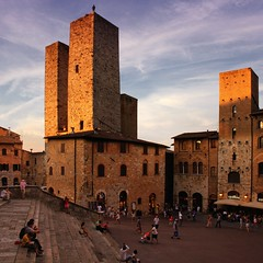 Unforgettable skyline of San Gimignano (Bn) Tags: old city light sunset red summer sky italy orange sunlight house man colour tower colors sunshine wall fairytale naked high topf50 san artist italia ray glow berries estate gimignano heart wine small hill inspired ground vessel exhibit unesco hills beam vineyards valley tuscany grapes villa chianti belle vista layers cypress summertime taste piazza roads sangimignano middle antony product viewpoint topf100 ages sculptor gormley vino torri erbe tuscan delle cultivated hillsides harmonious 100faves 50faves provinceofsiena