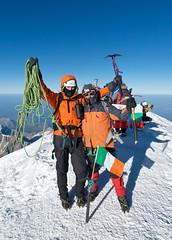 Mont Blanc ... 3 (TomFahy.com) Tags: travel people mountain snow france alps landscape climb flag climbing alpine mountaineering summit chamonix montblanc sonydscr1