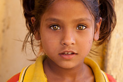 Hazel eyes, Jaipur (Marji Lang) Tags: travel portrait people india cute eye colors girl beautiful beauty face look childhood yellow closeup golden amber kid intense eyes colorful warm child looking sweet expression indian documentary yeux