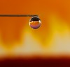 Fight fire with water (DMCleveland) Tags: macro reflection water closeup fire waterdrop needle refraction waterdropmacro colorphotoaward roccotaco waterdropsmacros sonynex7