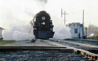 Norfolk Southern operated modern Norfolk & Western 2-6+6-4 A-class articulated steam locomotive # 1218, is preparing to haul a railfan excursion train across a diamond in Chattanooga, Tennessee, October 1987, Alternate View